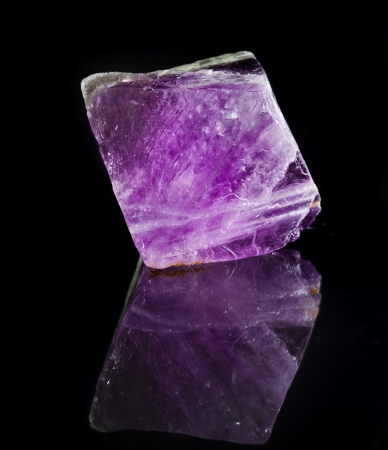 halide: Fluorite Crystal Purple with reflection on black surface background