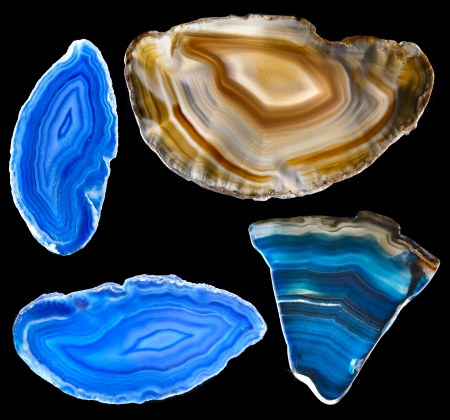 Collection of A slice of blue agate crystal with reflection on black surface background photo