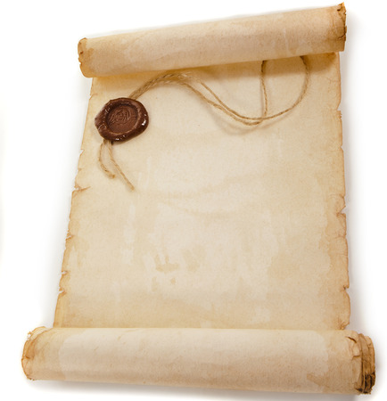 old scroll paper with a wax seal isolated on a white background photo
