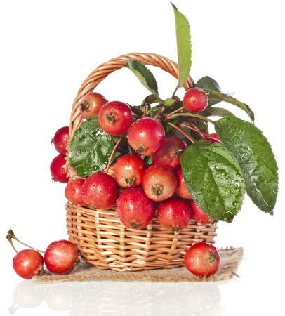 Apple fruits in wooden basket Isolated on a white background photo