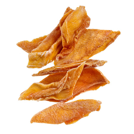 dehydrated: closeup of dried mango fruit slices, isolated on a white background Stock Photo