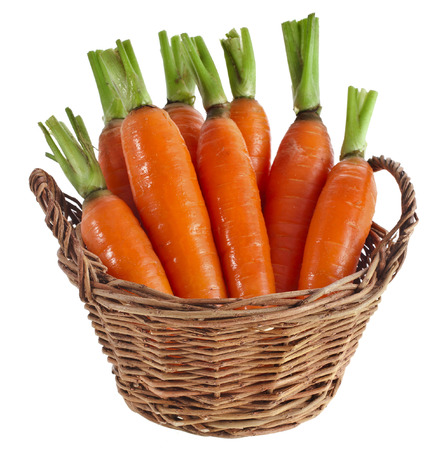 isilated: Carrot vegetables in a wooden basket isilated over white