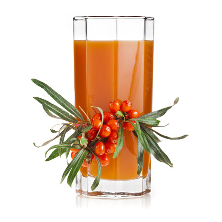 sallow: sea buckthorn berries juice on the glassful isolated on white background Stock Photo