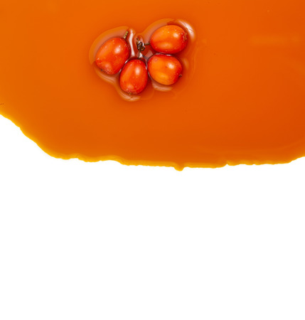 sallow: Border of sea-buckthorn oil pouring texture, isolated on the white background