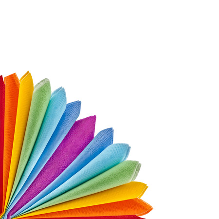 colored paper: Corner border of Serving colored paper napkins isolated on white background
