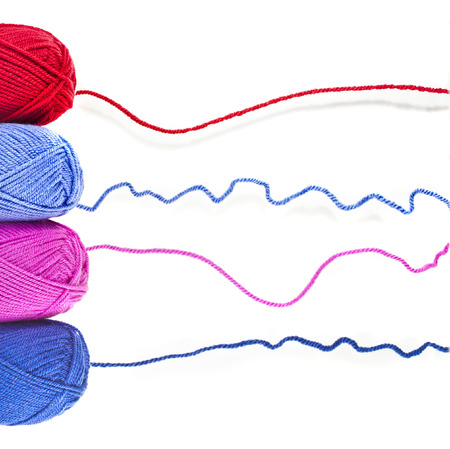 colored yarn thread isolated on white background Stock Photo