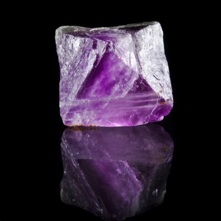 fluorite: Fluorite Crystal Purple with reflection on black surface background