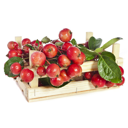 Apple fruits heap in wooden box crate Isolated on a white background photo