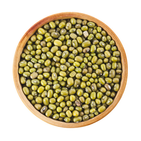 Green bean or mung bean in wooden bowl, top view close up isolated on a white background photo