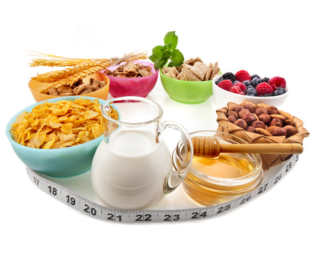nutritionist: Diet weight loss breakfast concept with tape measure, isolated on a white background