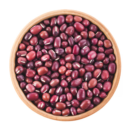 adzuki bean: Small red beans in wooden bowl, top view surface close up isolated on a white background