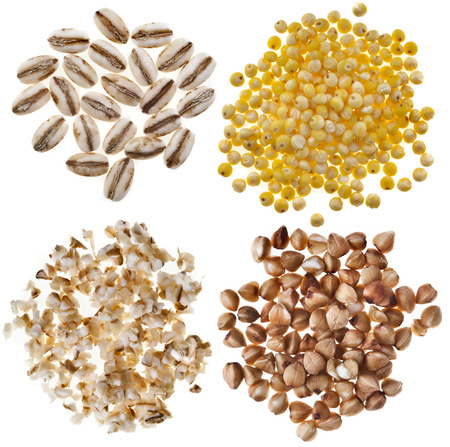millet: Different kinds group heap grains   pearl barley, millet, wheat semolina, buckwheat close up macro top view isolated on white background Stock Photo