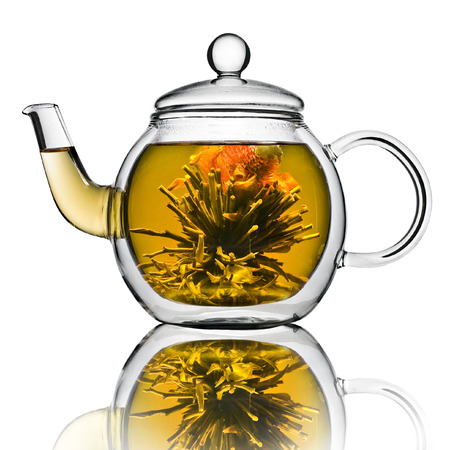 yellow tea pot: A glass tea pot with Flower Chinese tea isolated on a white background Stock Photo
