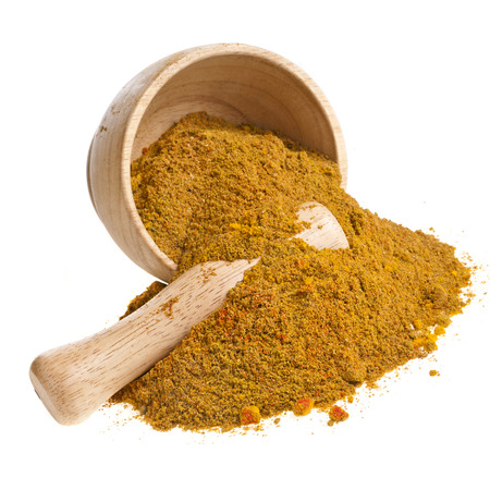 curcumin: mortar with curry powder spice isolated on white background
