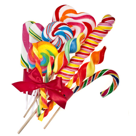 candy hearts: colorful lollipop with red ribbon bow isolated on white