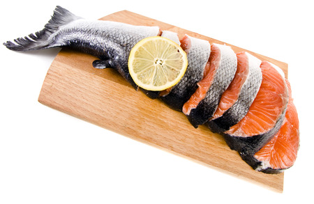 pink salmon: fresh salmon on a cutting wood kitchen board surface isolated on white background