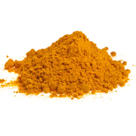 peppery: Turmeric powder spice pile isolated on white background Stock Photo