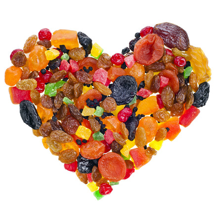 mix dried fruits heart shape collection on white photo
