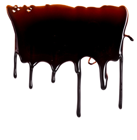 chocolate syrup: chocolate syrup leaking close up isolated on white background