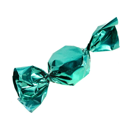 candy in green wrapper isolated on white background photo