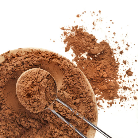 calorie rich food: cocoa powder with scoop isolated on white background