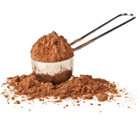 cocoa powder in scoop isolated on white background