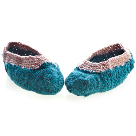 home knitted woolen slippers shoes isolated on white background photo