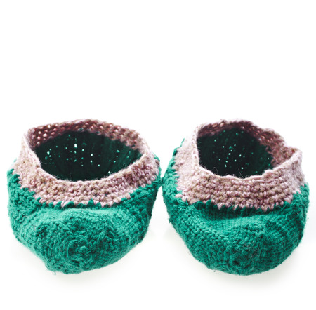homemade knitted woolen slippers shoes isolated on white background photo