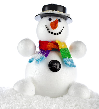 funny snowman with black hat sitting in a snowdrift  photo