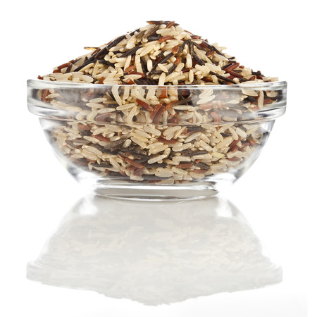 wild rice: color mix gourmet rice  brown, red, wild  in glass bowl isolated on white background Stock Photo