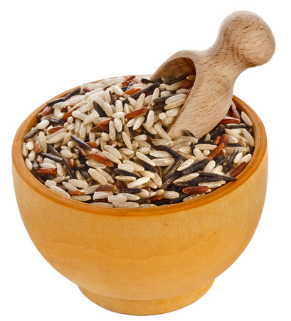 wild rice: mixed rice in wooden bowl with spoon scoop isolated on white background Stock Photo