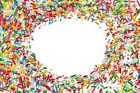 Border frame of colorful candy sprinkles isolated on white background card for text photo