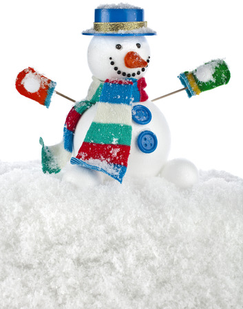 funny snowman in a striped scarf , mittens with blue hat , sitting on a snowdrift isolated on white background