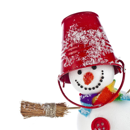 Cheerful snowman with red color bucket on his head and broom in hand isolated on white background Stock Photo