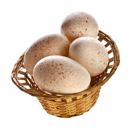 Eggs in basket isolated on white background with clipping path photo