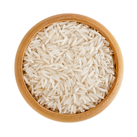 basmati: Polished long rice basmati in a wooden bowl isolated on white background