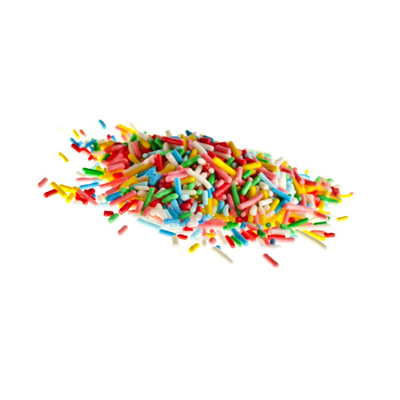 solated: Colorful candy sprinkles pile hill solated on white background