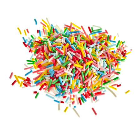 Colorful candy sprinkles heap close up isolated on white background Stockfoto
