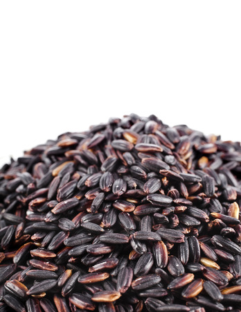 Pile of Brown Rice Close up Macro Isolated on White Background photo