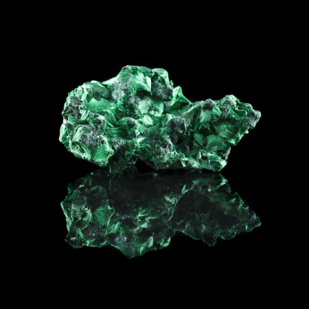 malachite: malachite mineral stone close up with reflection on black surface background Stock Photo