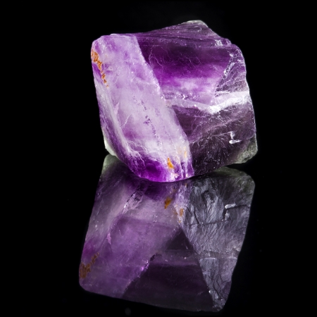 halide: Beautuful Big Fluorite Crystal Purple with reflection on black surface background Stock Photo