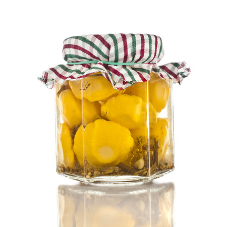 cymbling: natural squash pattypan homemade canned preserved in glass jars pots isolated on white background