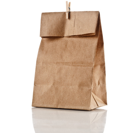 paper bag with clip isolated on white background photo