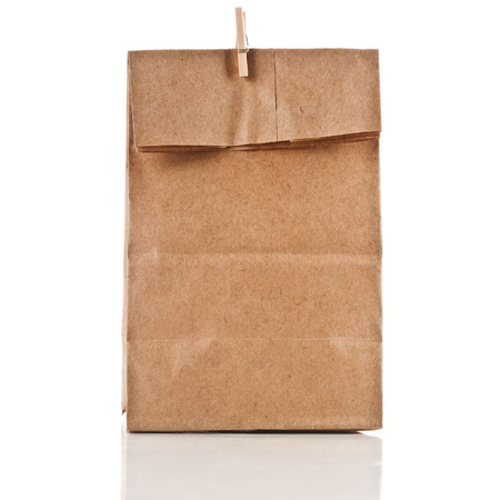 paper bag with wooden clip isolated on white background photo