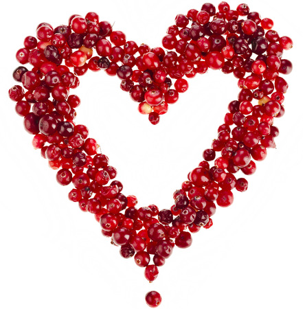 frame of ripe cranberries heart card surface top view isolated on white background photo