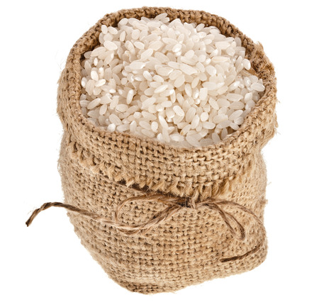 basmati rice in small burlap sack isolated on white background photo