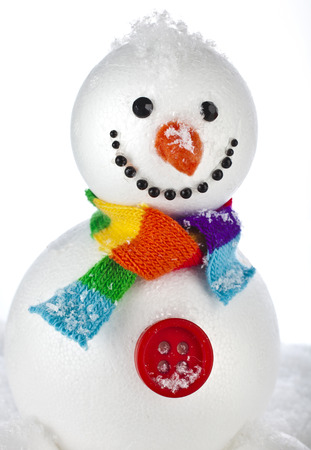 funny hairless snowman sitting on a snowdrift isolated on white background Stock Photo