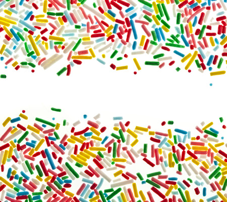 Border frame of colorful candy sprinkles isolated on white card for text photo
