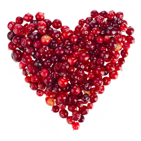 ripe cranberries in the form heart surface top view isolated on white background photo