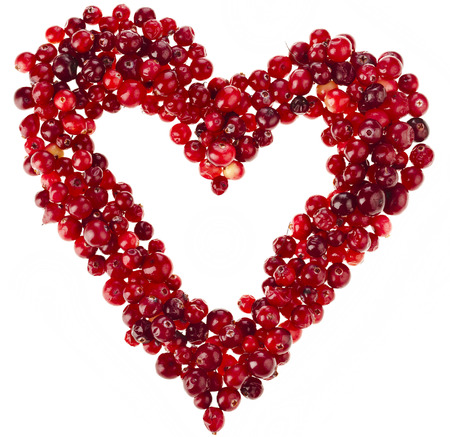 Heart frame card of fresh cranberries surface with copy space isolated on white background photo